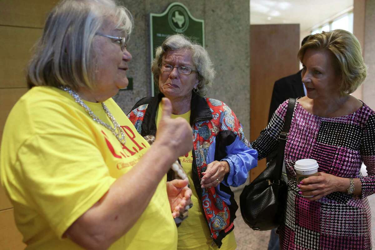 Morrison (right) listens to an emotional Hull (center) and to Level after the Texas Railroad Commission granted a permit for an oil field landfill on the outskirts of Nordheim. Morrison said she told commissioners she understood that they couldn't consider the ramifications of permits - an issue she said should be tackled in the next legislative session while the agency is under Sunset Review.