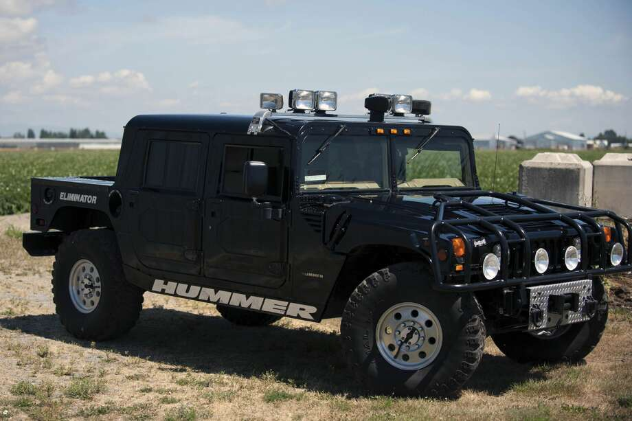 This Hummer, up for an online auction later this month, was originally owned by slain rapper Tupac Shakur. Photo: Courtesy/RR Auction