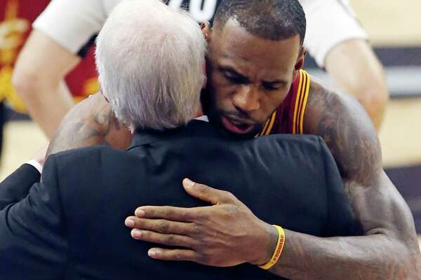 San Antonio Spurs head coach Gregg Popovich hugs Cleveland Cavaliers' LeBron James before the game Thursday Jan. 14, 2016 at the AT&T Center.