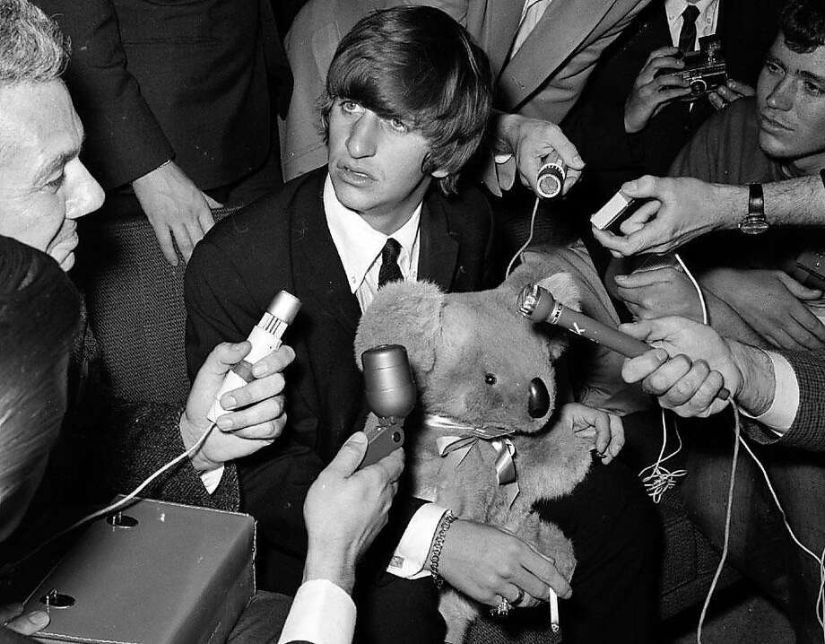 The Beatles' Ringo Starr encountered bedlam, and a lot of microphones, when he stopped at San Francisco International Airport on June 12, 1964, on his way to Australia to meet up with the band. Photo: Gordon Peters, The Chronicle 1964