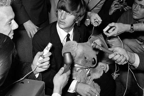 The Beatles' Ringo Starr encountered bedlam, and a lot of microphones, when he stopped at San Francisco International Airport on June 12, 1964, on his way to Australia to meet up with the band.