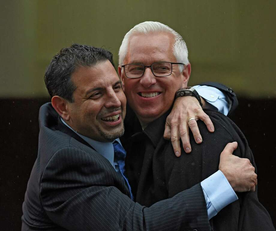 Owner Mike Repole, left gives trainer Todd Pletcher a big hug after his horse Outwork won the 92nd running of the Wood Memorial at Aqueduct Park April 9, 2016 in Ozone Park, N.Y.    (Skip Dickstein/Times Union) Photo: SKIP DICKSTEIN