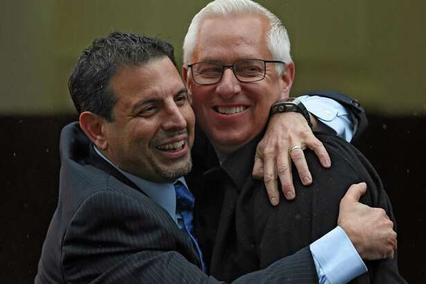 Owner Mike Repole, left gives trainer Todd Pletcher a big hug after his horse Outwork won the 92nd running of the Wood Memorial at Aqueduct Park April 9, 2016 in Ozone Park, N.Y.    (Skip Dickstein/Times Union)