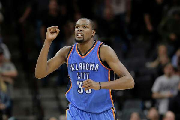 Oklahoma City Thunder forward Kevin Durant (35) celebrates a score against the San Antonio Spurs during the second half in Game 2 of a second-round NBA basketball playoff series, Monday, May 2, 2016, in San Antonio. Oklahoma City won 98-97. (AP Photo/Eric Gay)