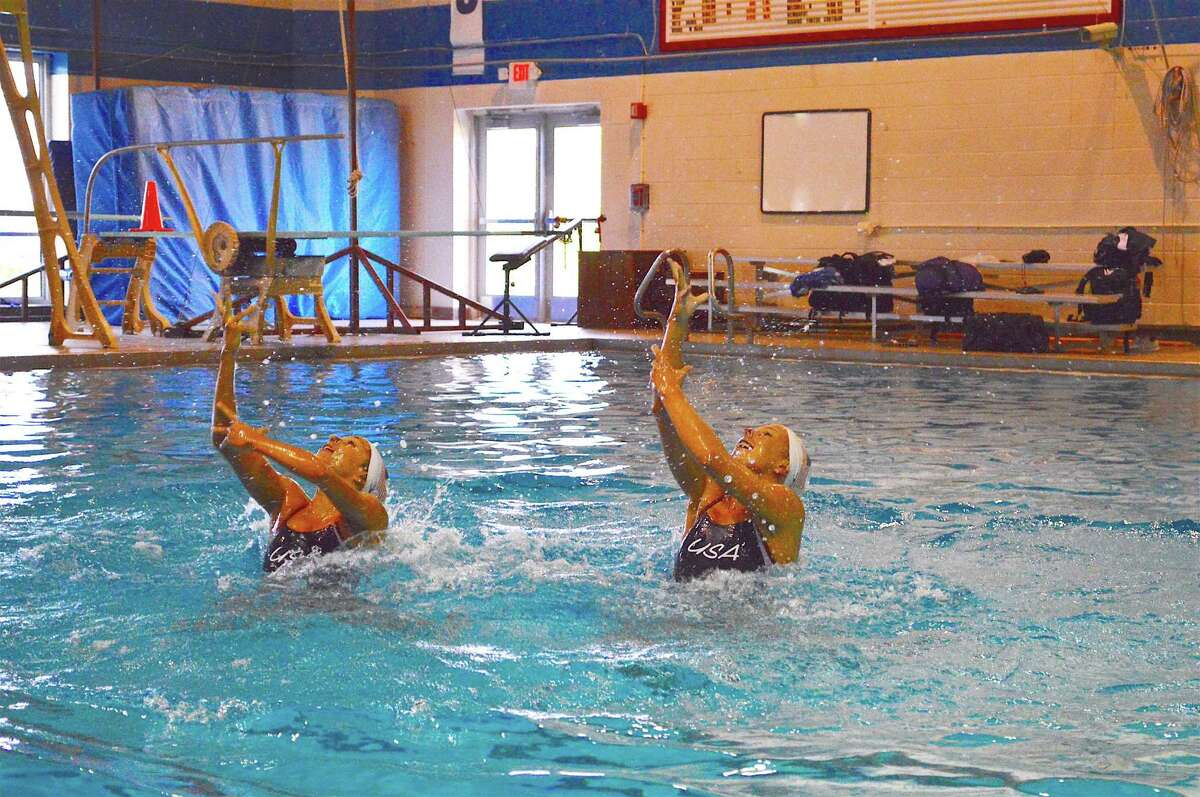 Olympiads Anita Alvarez and Mariya Koroleva perform a routine in the pool at the New Canaan Y.