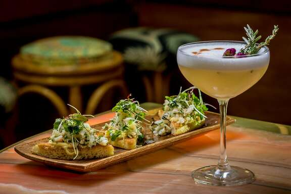 """Rock Shrimp Toast with the """"Garden Party"""" cocktail at Leo's Oyster Bar in San Francisco, Calif., is seen on May 2nd, 2016."""