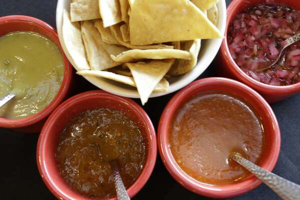 SALTILLO MEXICAN KITCHEN 5427 Bissonnet; saltillomexicankitchen.com Salsafication: You get four-count-'em-four table salsas to play with, each one formidable in its own right. The champion? An unusual minced-red-onion salsa that's almost a relish, lit up by fruity habanero chile and twinged with fragrant Mexican oregano. A touch of olive oil and orange rounds out the flavors and textures. Brilliant on everything from chips to the mesquite-grilled, Norteño-style beef that's a specialty here. Multiple salsas? Yes. The tomatillo salsa, the mildest of the four, is a tart, spring-green purée. The perfectly calibrated red salsa, slightly pulpy and flecked with chile seeds, gets an intriguing umami note from chicken broth, and it bursts with front-of-the-mouth heat that spreads and fades to a lingering warmth. Fourth comes a bright, sunny habanero/papaya purée in which the papaya's fruitiness tempers the distinctive habanero sear while salt sharpens it. Free: Yes. Chips: Sturdy, fried-in-house totopos with a layer-y effect. Grade: Extraordinary (red onion; red salsa); excellent (tomatillo, habanero). Other: Though the salsas merit a trip in themselves, the Norteño-style food at this upscale, dining-clubby Bellaire spot is terrific, and the house margarita, shaken and served straight up, is one of the city's best.