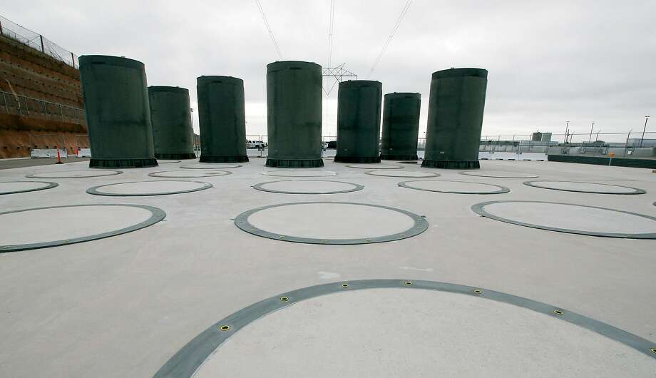 Concrete casks store radioactive waste from the nuclear reactors at PG&E's Diablo Canyon Nuclear Power Plant in 2008. After the plant closes in 2025, all of its used fuel will be moved into such casks, which are bolted into a 7-foot-thick concrete pad to protect against earthquakes. Photo: Michael A. Mariant / Associated Press 2008