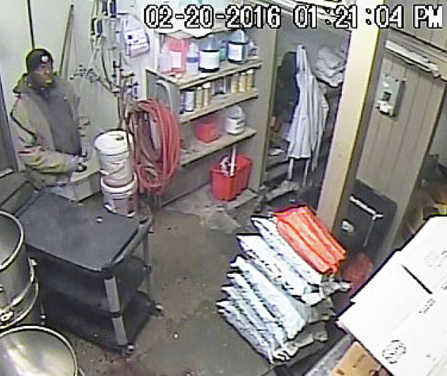 The man in this video surveillance image from Pepe's Pizzeria -- identified by police as Craig Reynolds, 43, of Bridgeport -- has been charged with theft of cash and jewelry from an employee's purse at the Commerce Drive business. Photo: Fairfield Police Department / Fairfield Police Department / Fairfield Citizen