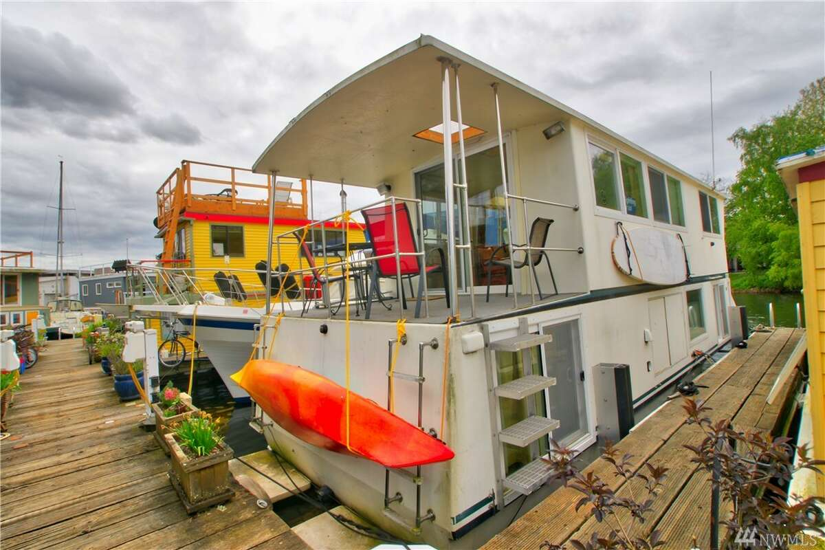 The first home,2143 N. Northlake Way #62, is listed for $398,000. The two-bedroom, one-bathroom home is 960 square feet and is right next door to Gas Works Park. The home is technically a houseboat, and therefore has a slightly different permit and regulatory process than a floating home. For more specifics on the distinction, visit the City of Seattle's website. You can see the full listing here.