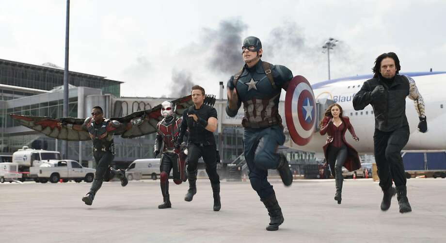 "Anthony Mackie (left), Paul Rudd, Jeremy Renner, Chris Evans, Elizabeth Olsen and Sebastian Stan in ""Captain America: Civil War."" Photo: Associated Press"