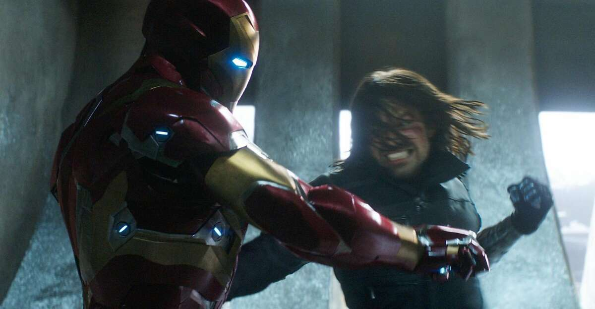 This image released by Disney shows Robert Downey Jr., left, and Sebastian Stan in a scene from Marvel's
