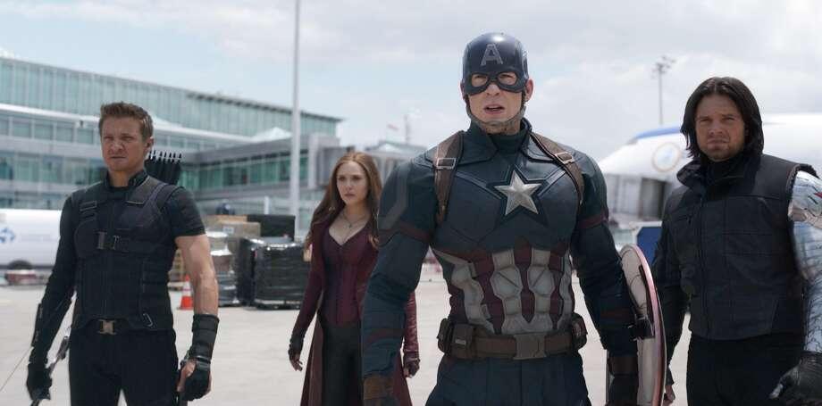 Jeremy Renner, Elizabeth Olsen, Chris EvansSebastian Stan in a still from Marvel's Captain America: Civil War. Photo: ©2016, Marvel