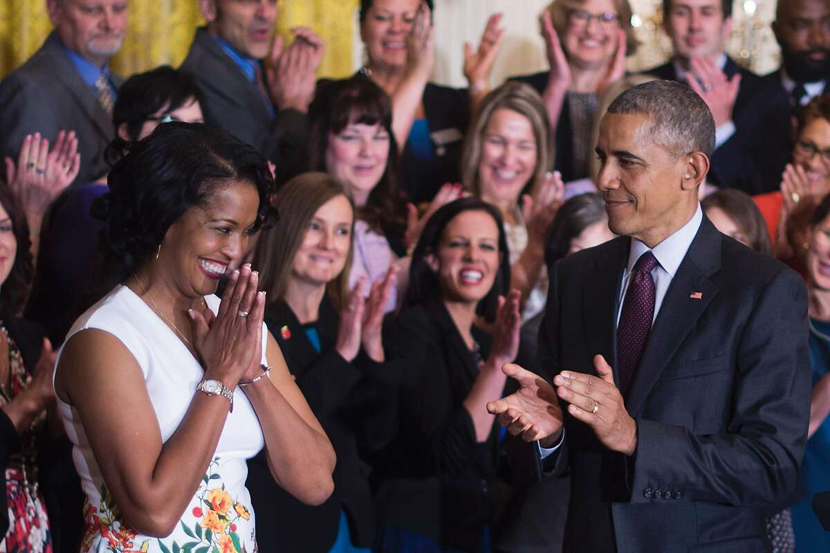 Jahana Hayes celebrates winning the 2016 National Teacher of the Year as US President Barack Obama (C) looks on during an event at the White House in Washington, DC, May 3, 2016.