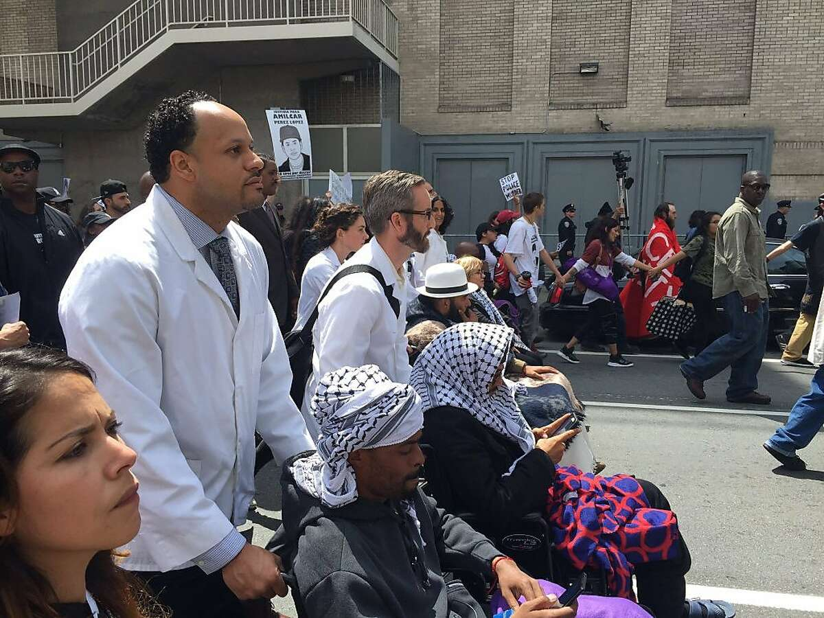 Protesters who have been on a hunger strike for 13 days march with others to City Hall demand that Police Chief Greg Suhr is fired May 3, 2016 in San Francisco, Calif.