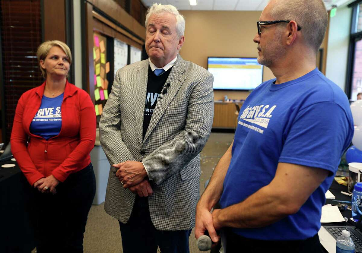 San Antonio Area Foundation CEO Dennis Noll, flanked by Big Give planning team member Carrie Gray, left, and the Nonprofit Council Executive Director Scott McAninch, right, explain the computer server problems Big Give SA had Tuesday with donation processor Kimbia of Austin.