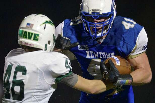 Newtown's Ben Mason runs against New Milford on Nov. 6, 2015.