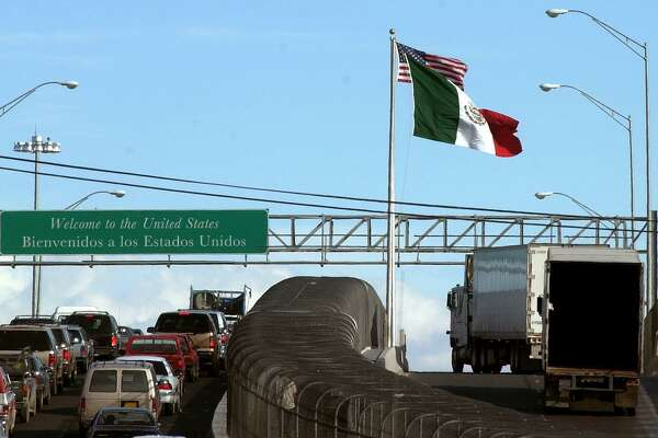 Trucks from Mexico are driven on an international bridge leading to El Paso in this file photo. Blaming trade for all our economy's ills is not just wrong, it's not enough.