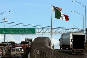 Mexican trucks drive on an international bridge leading to El Paso, Texas Wednesday, Feb. 7, 2001. Despite provisions in NAFTA, it wasn't until the end of the Obama administration that Mexican trucks were allowed to haul loads deep into the U.S.