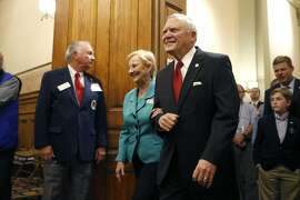 Georgia Gov. Nathan Deal walks with his wife Sandra as they visit the Senate chambers during the final day of the general assembly Thursday, March 24, 2016, at the state Capitol in Atlanta. (AP Photo/Jason Getz)