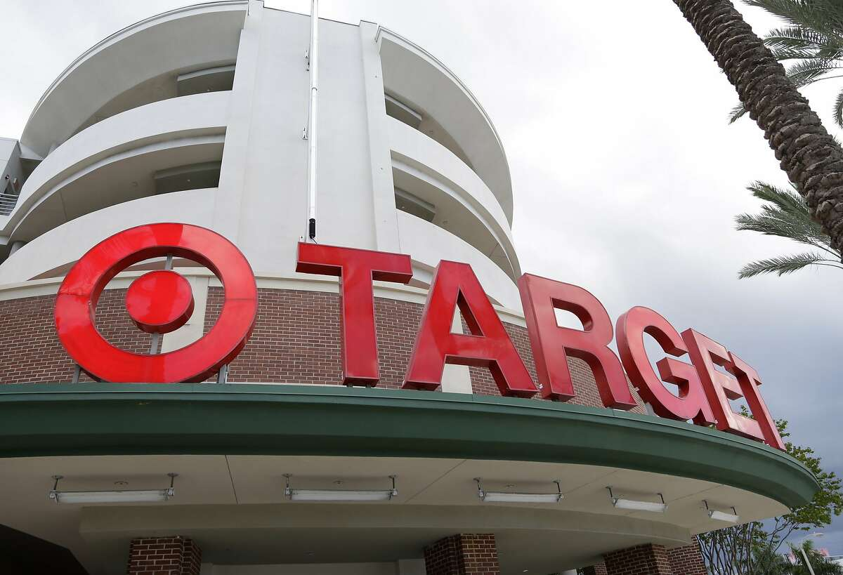 """FILE - This Monday, Aug. 11, 2015, file photo, shows a Target store in Miami. Target is making a stand on the debate around what type of bathrooms transgender people can use. In a statement posted on its company website Tuesday, April 19, 2016, the discounter, based in Minneapolis, said transgender employees and customers can use the restroom or fitting room facility that """"corresponds with their gender identity."""" (AP Photo/Lynne Sladky, File)"""