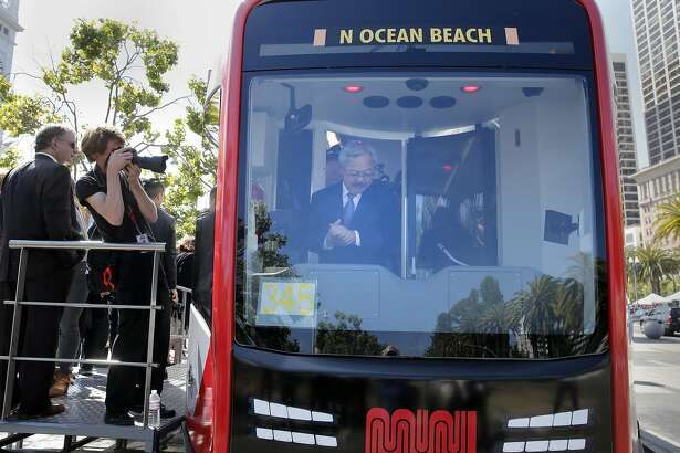 San Francisco Mayor Ed Lee checked out the controls of the new light rail vehicle Tuesday June 16, 2015. SFMTA unveiled a wooden mockup of its new Muni Metro car near the Ferry building in San Francisco, Calif. The agency ordered 260 new rail cars last July at a cost of $1.2 billion.