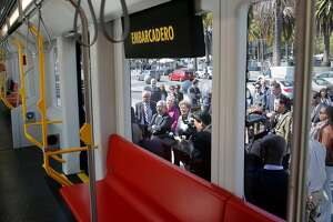 San Francisco Mayor Ed Lee spoke with officials during his tour of the new light rail car Tuesday June 16, 2015. SFMTA unveiled a wooden mockup of its new Muni Metro car near the Ferry building in San Francisco, Calif. The agency ordered 260 new rail cars last July at a cost of $1.2 billion.