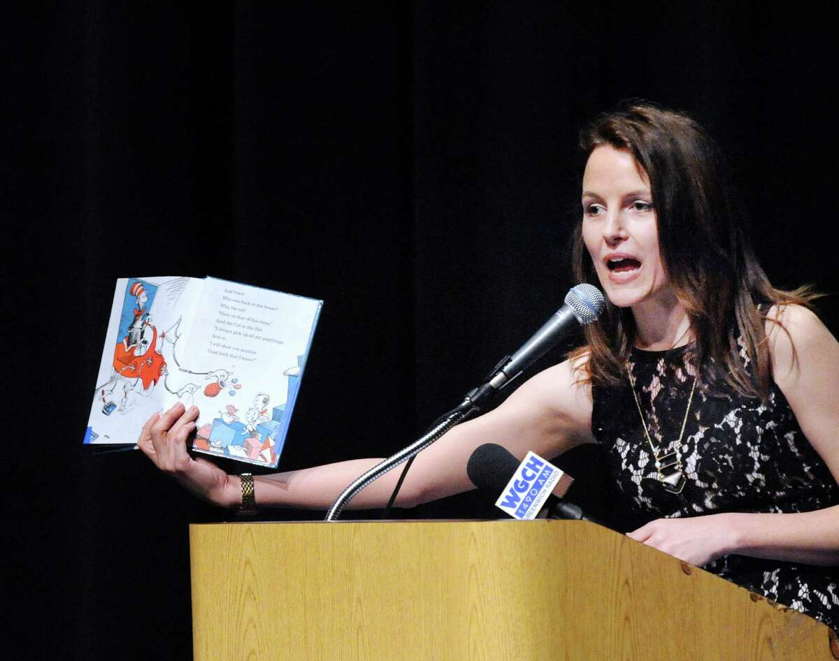 """Sarah Goldin, a Greenwich High School Science-AVID-Innovation Lab teacher, held up """"The Cat in the Hat"""" book by Dr. Seuss, while speaking after being honored as one of six Greenwich Public Schools Distinguished Teachers during an awards ceremony at the Greenwich High School Performing Arts Center, Conn., Tuesday, May 3, 2016."""