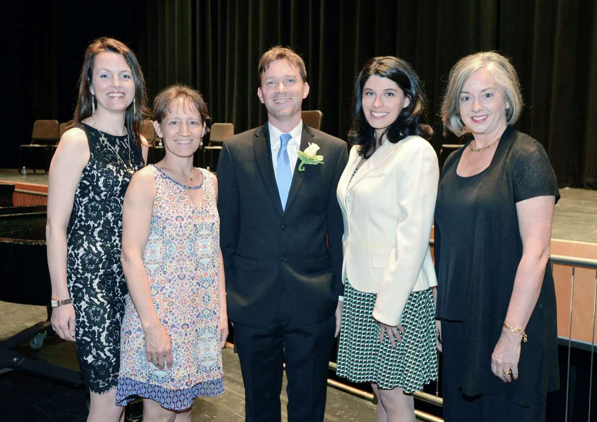 The Greenwich Public Schools Distinguished Teachers Awards Ceremony at the Greenwich High School Performing Arts Center, Conn., Tuesday, May 3, 2016. Six teachers were recognized for their excellence, they are from left, Sarah Goldin of Greenwich High School, Sarah Harris of North Mianus School, Ian Tiedemann of Greenwich High School, Ana Chejin-Danielsen of New Lebanon School and Jeannine Madoff of the International School at Dundee. Julie Cofone of North Mianus School was also honored but did not attend the ceremony due to the birth of a child.