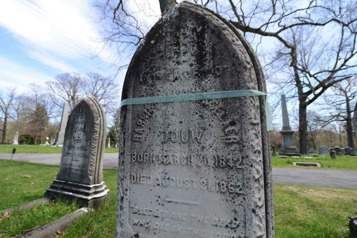 The tombstone of Harriet Van Rensselaer, with blue tape, has been earmarked for repair in the Van Rensselaer plot at Albany Rural Cemetery on Thursday, April 28, 2016, in Menands, N.Y. (Will Waldron/Times Union)