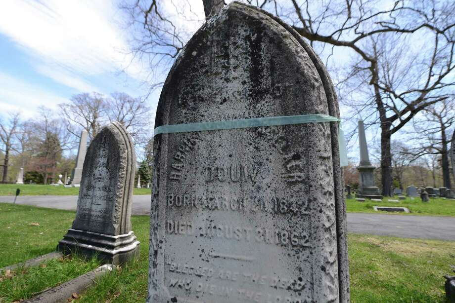 The tombstone of Harriet Van Rensselaer, with blue tape, has been earmarked for repair in the Van Rensselaer plot at Albany Rural Cemetery on Thursday, April 28, 2016, in Menands, N.Y. (Will Waldron/Times Union) Photo: Will Waldron / 10036407A