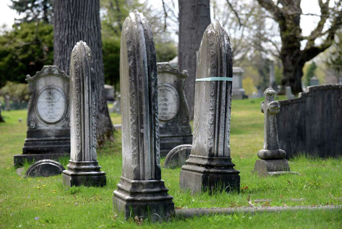 The tombstone of Harriet Van Rensselaer, right with blue tape, has been earmarked for repair in the Van Rensselaer plot at Albany Rural Cemetery on Thursday, April 28, 2016, in Menands, N.Y. (Will Waldron/Times Union)