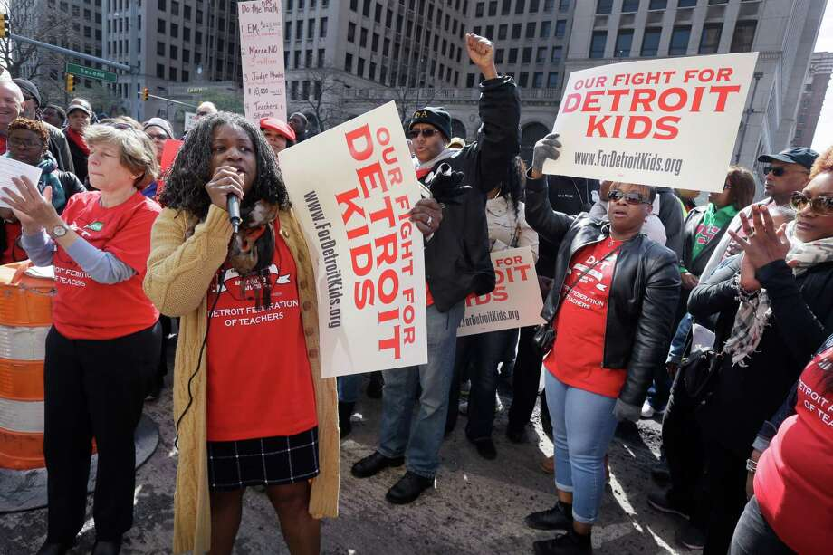 Detroit Federation of Teachers President Ivy Bailey addresses teachers outside the school district's headquarters, Tuesday, May 3, 2016 in Detroit. Nearly all of Detroit's public schools were closed for a second consecutive day Tuesday after hundreds of teachers called out sick over concerns that many may not get paid if the financially struggling district runs out of money. (AP Photo/Carlos Osorio) Photo: Carlos Osorio, STF / Copyright 2016 The Associated Press. All rights reserved. This material may not be published, broadcast, rewritten or redistribu