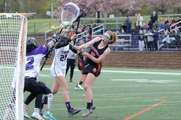 Stamford's Caroline Ryan scores in the first half as Westhill High School hosts Stamford High School in girls varsity lacrosse in Stamford, CT on May 3, 2016.