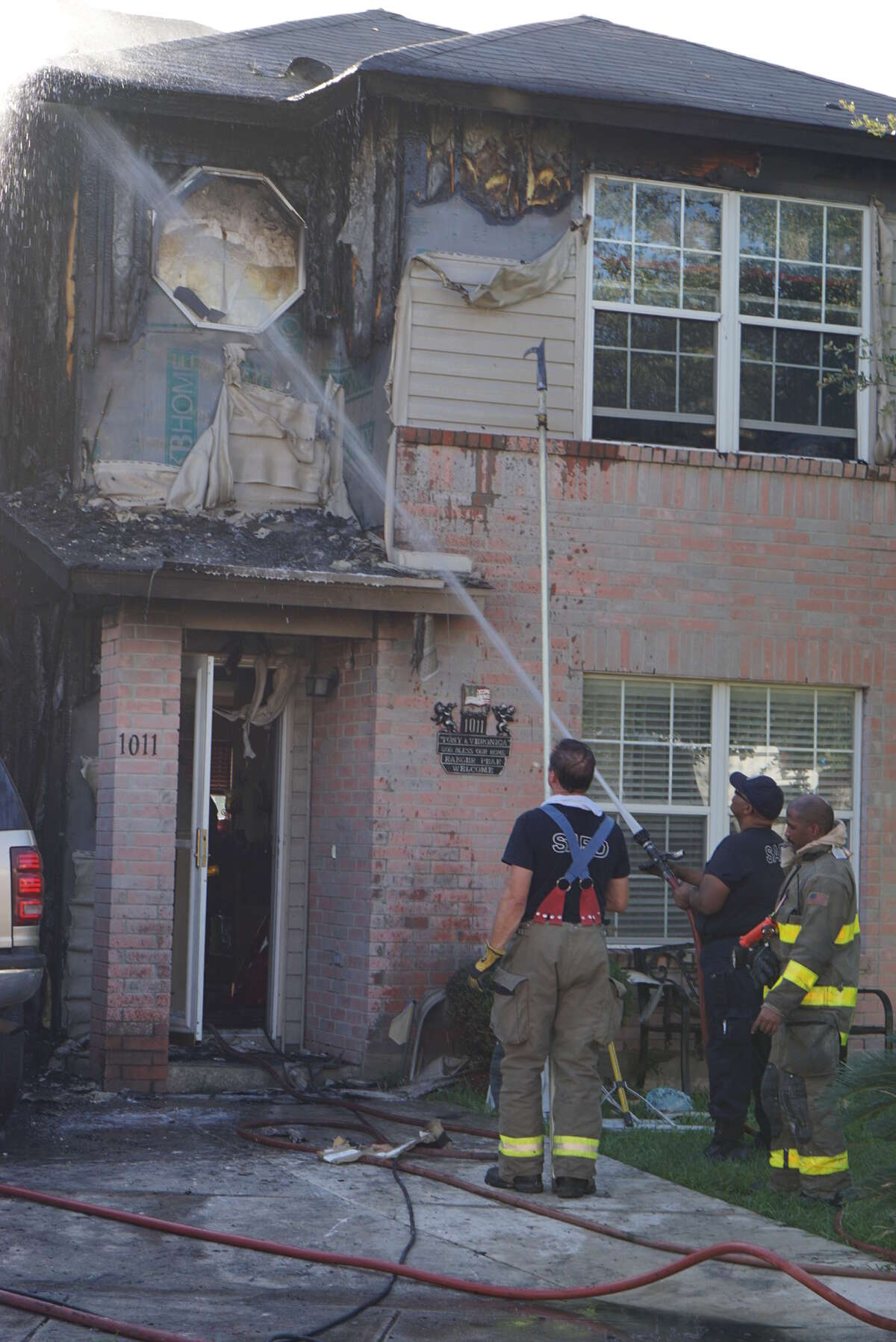 Flames burned through a home Tuesday afternoon after a vehicle in the driveway caught fire at about 5 p.m. in the 1000 block of Ranger Peak on the Northwest Side.