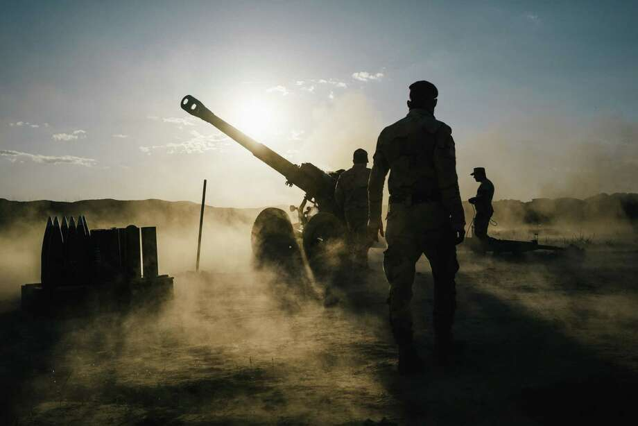 Iraqi soldiers fire artillery toward Islamic State positions from a location outside Makhmour, Iraq. U.S. troops are moving outside the confines of more established bases to give closer support. / Alice Martins