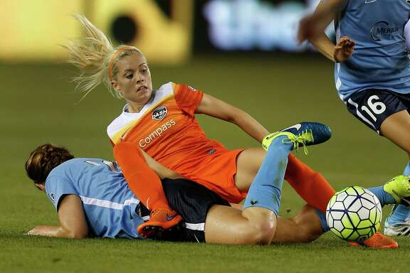 Houston Dash Denise O'Sullivan (13) crashes into Sky Blue FC midfielder Ashley Nick (10) during the second half of a National Women's Soccer League game at BBVA Compass Stadium, Friday, April 29, 2016, in Houston.  ( Karen Warren  / Houston Chronicle )