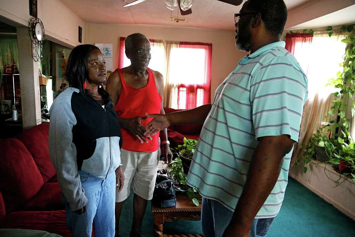 Tres Davis, right, visited Doris and Henry Bonner while canvassing in Richmond on Monday. Davis seeks more representation for majority-black North Richmond, which gets cut off from most of the city every 18 minutes as trains close the one route out.