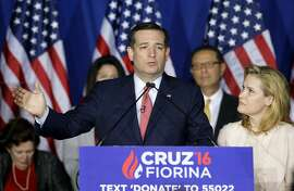 Republican presidential candidate, Sen. Ted Cruz, R-Texas, speaks as his wife, Heidi, listens during a primary night campaign event, Tuesday, May 3, 2016, in Indianapolis. (AP Photo/Darron Cummings)