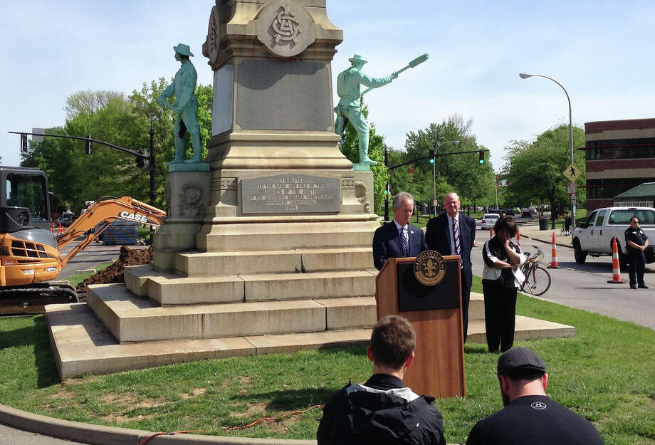 Louisville Mayor Greg Fischer, right,  and University of Louisville President James Ramsey, left, announced at a surprise press conference that the Confederate monument capped with a statue of Jefferson Davis will be removed. Photo: Dylan Lovan, STF / ap