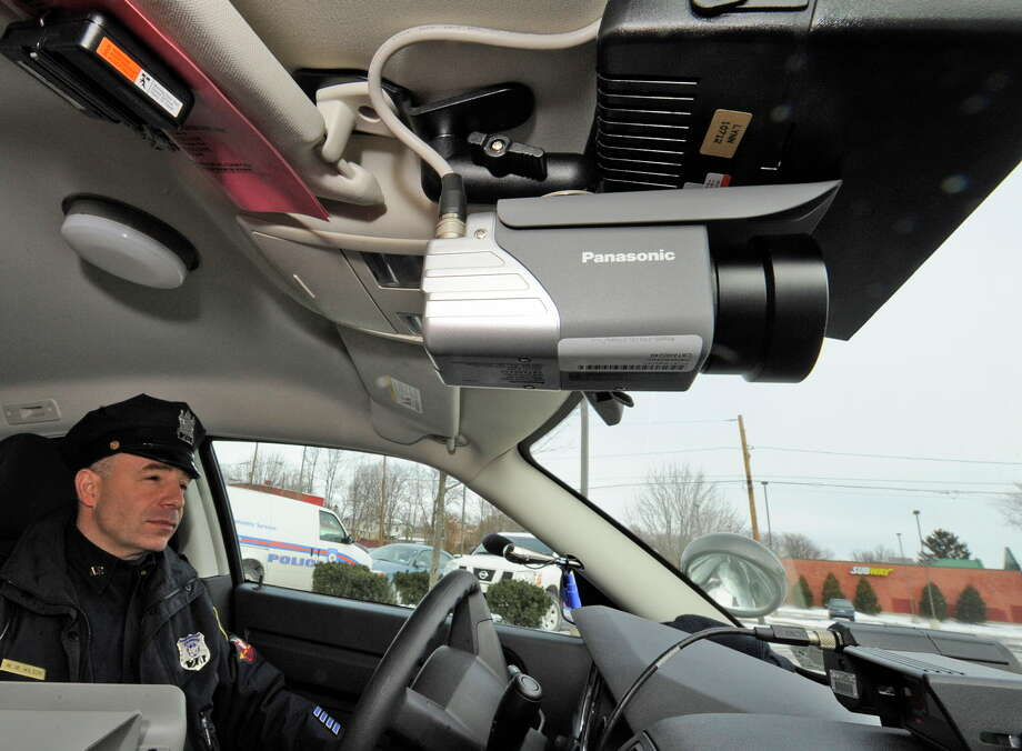 Albany Police Officer William Wilson with the new police camera on board his cruiser on Jan. 5, 2010, in Albany, N.Y. The Troy Public Safety Committee will take up outfitting the city?s police cars with dashboard cameras.  (Skip Dickstein/Times Union archive) Photo: Skip Dickstein / 2008