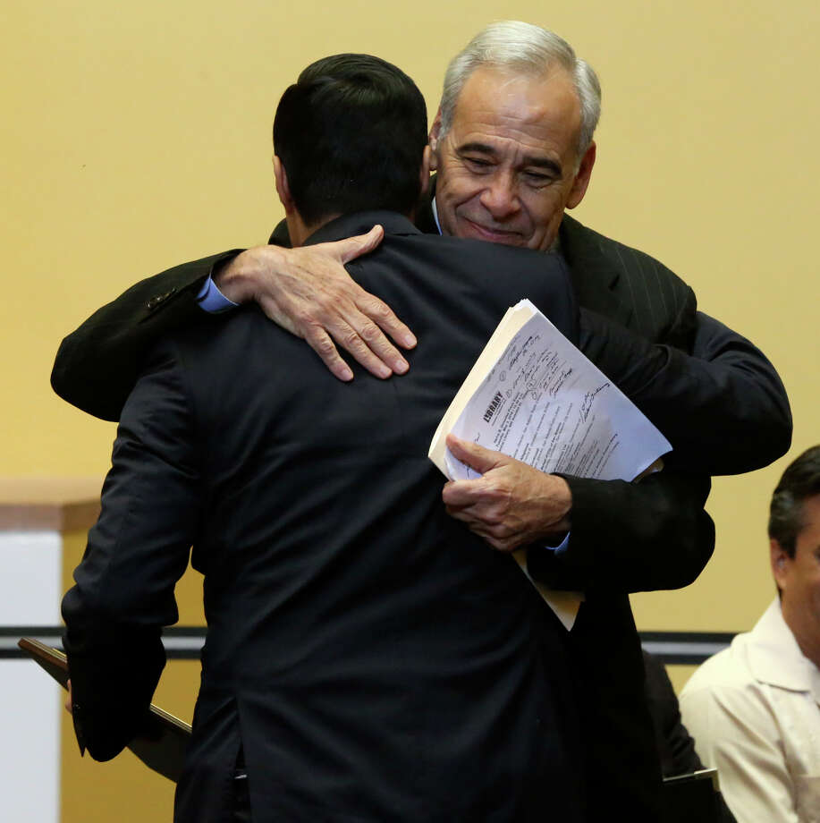The Honorable Charles Gonzalez (facing), former House of Representatives, 20th Congressional District of Texas, hugs with the Honorable Joaquin Castro (facing away), House of Representatives 20th Congressional District of Texas during a ceremony Tuesday May 3, 2016 at the Central San Antonio Public Library honoring Charles Gonzalez's late father, Congressman Henry B. Gonzalez. The ceremony was held on what would have been Henry B. Gonzalez's 100th birthday. Photo: John Davenport, Staff / San Antonio Express-News / ©San Antonio Express-News/John Davenport