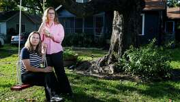 Foster parents Carol Jeffery, left, and Angela Sugarek sit on a swing they built for their two foster children  Wednesday, April 27, 2016 in Houston. The couple had the two bothers, ages three and four, taken away from them by Child Protective Services after reporting that they believed the younger child was being abused by an older brother. ( Michael Ciaglo / Houston Chronicle )