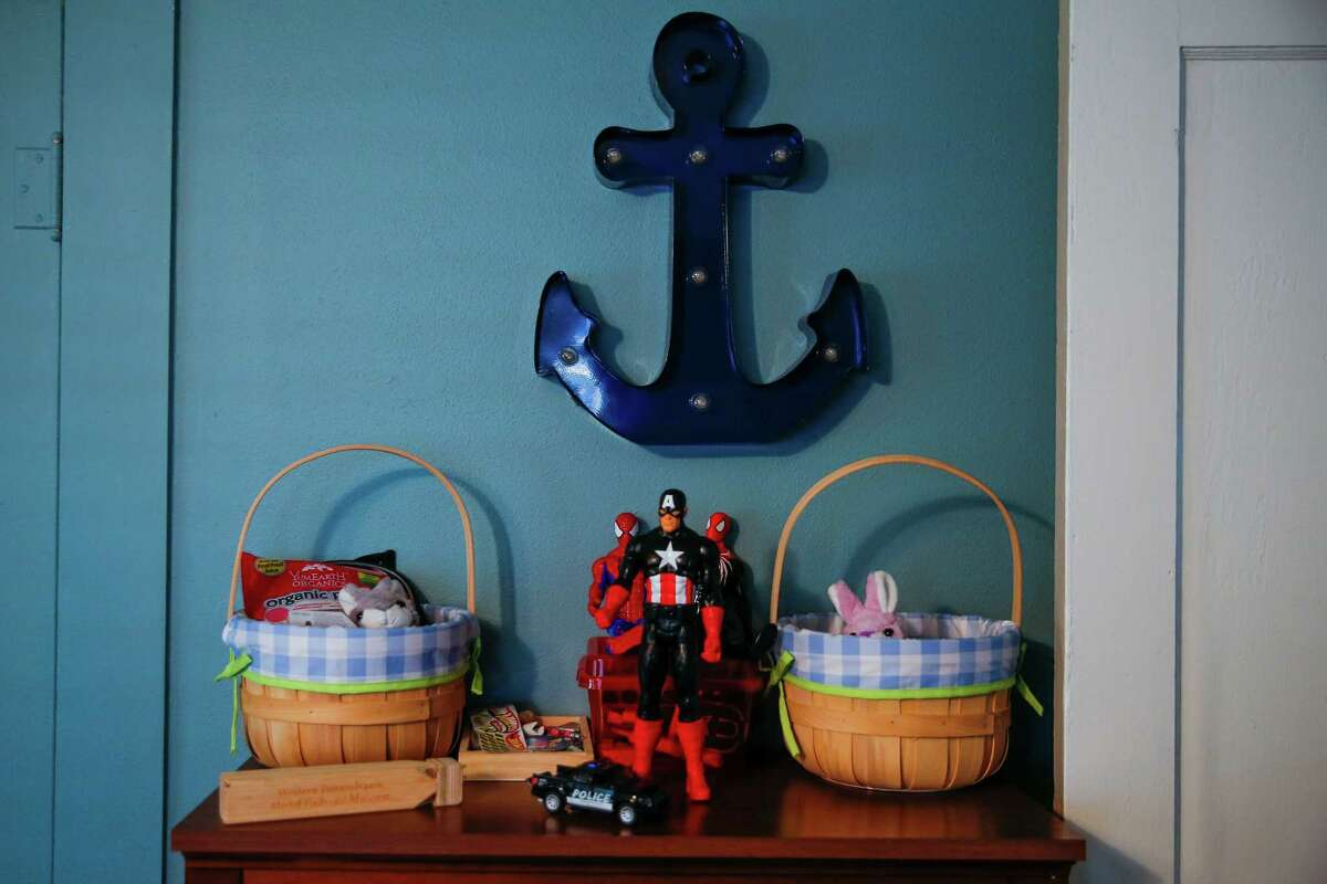 Action figures and Easter baskets sit last week on a bookshelf in the room of two foster kids who were removed from the home of their foster parents, who reported sexual abuse by the boys' older brother.