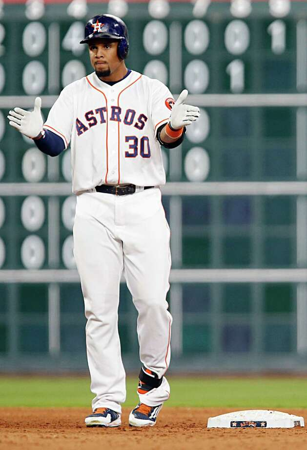 Houston Astros center fielder Carlos Gomez reacts after hitting a double against the Minnesota Twins during the fourth inning of MLB game action at Minute Maid Park Tuesday, May 3, 2016, in Houston. Photo: James Nielsen, Houston Chronicle / © 2016  Houston Chronicle