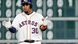Houston Astros center fielder Carlos Gomez reacts after hitting a double against the Minnesota Twins during the fourth inning of MLB game action at Minute Maid Park Tuesday, May 3, 2016, in Houston.