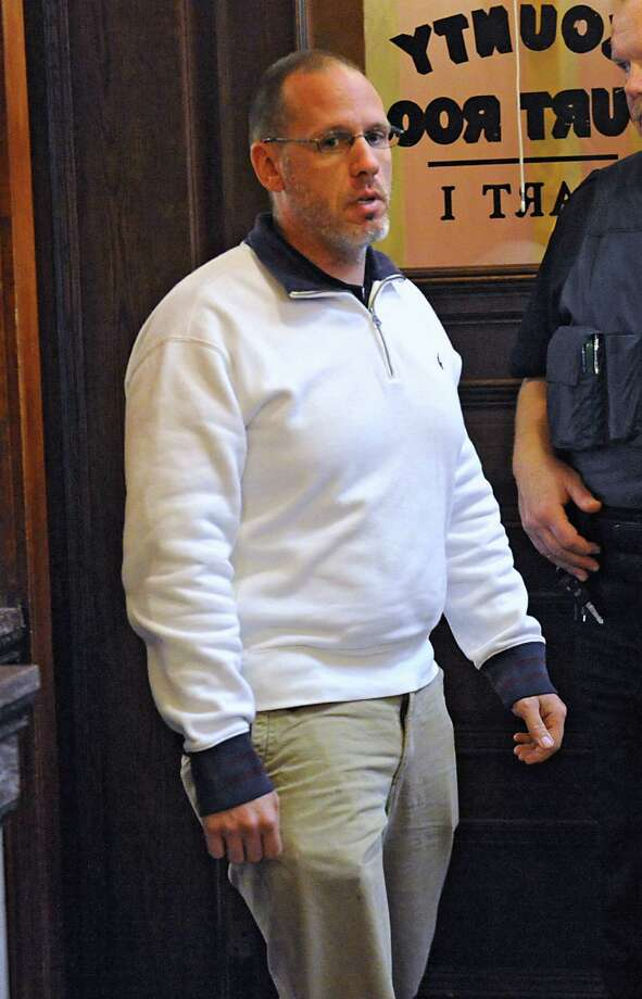 Troy police Sgt. Randall French leaves a courtroom where he was asked about the April 17 fatal shooting of a DWI as French testified in an unrelated trial at the Rensselaer County Courthouse on Monday, May 2, 2016. in Troy, N.Y. (Lori Van Buren / Times Union) Photo: Lori Van Buren / 20036443A