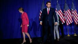 Sen. Ted Cruz and Carly Fiorina leave the stage after he suspended his presidential campaign at a primary night rally in Indianapolis, May 3, 2016. After Donald Trump was projected as the winner of Indiana's Republican primary, Cruz announced his withdrawal, all but assuring that Donald Trump will be the Republican nominee. (Eric Thayer/The New York Times)
