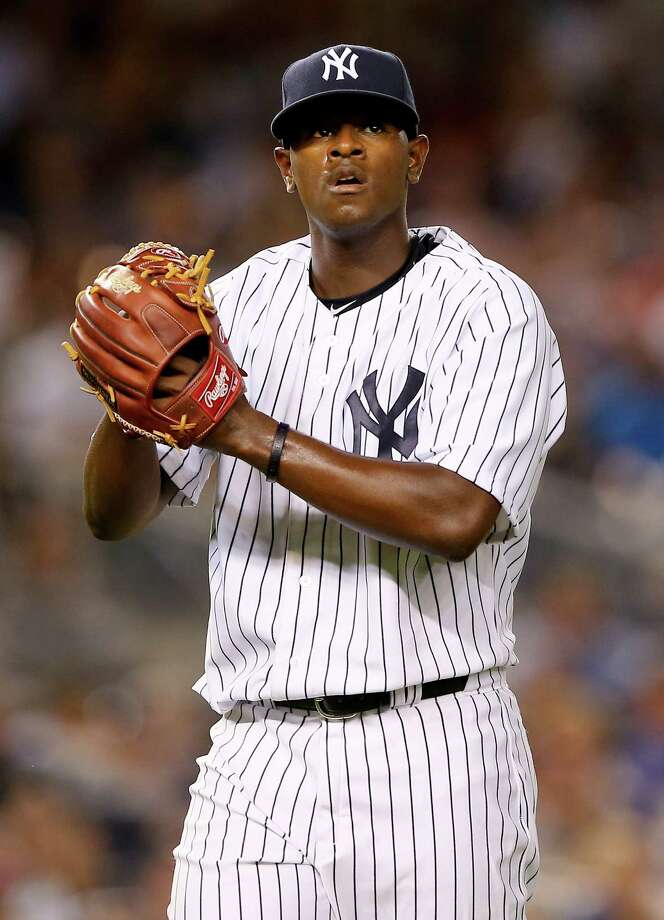 NEW YORK, NY - AUGUST 05:  Luis Severino #40 of the New York Yankees celebrates his final out of the fifth inning against the Boston Red Sox on August 5, 2015 at Yankee Stadium in the Bronx borough of New York City.Tonight's start is Severino's Major League debut.  (Photo by Elsa/Getty Images) ORG XMIT: 538588109 Photo: Elsa / 2015 Getty Images