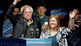 Democratic presidential candidate, Sen. Bernie Sanders, I-Vt., and his wife Jane O'Meara Sanders, wave after a campaign rally Tuesday, May 3, 2016, in Louisville, Ky. (AP Photo/Charlie Riedel)
